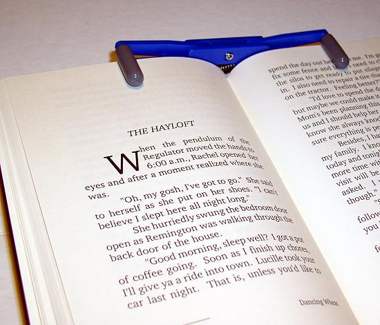 The FlipKlip by BlueZap is easy to use.  Just open the FlipKlip and place it on your book!